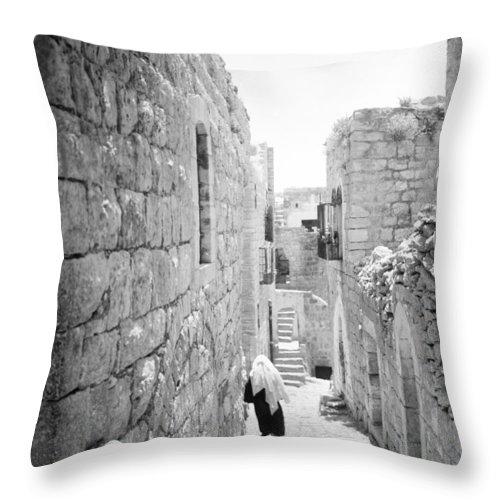 Bethlehem Throw Pillow featuring the photograph Bethlehem - Old Woman Walking 1933 by Munir Alawi