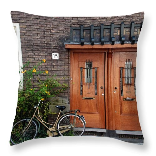 Bicycle Throw Pillow featuring the photograph Bicycle And Wooden Door by Thomas Marchessault