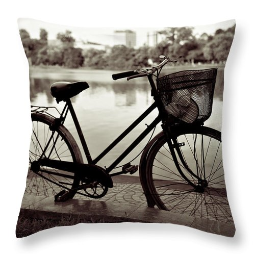 Bicycle Throw Pillow featuring the photograph Bicycle By The Lake by Dave Bowman