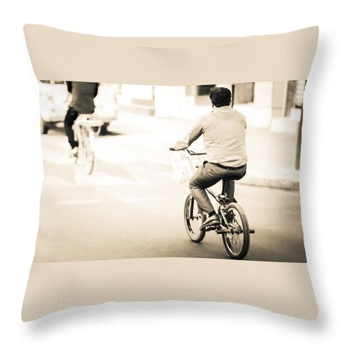 Site Pictures Throw Pillow featuring the photograph Bicycle Rider by Emmanuel Sanni