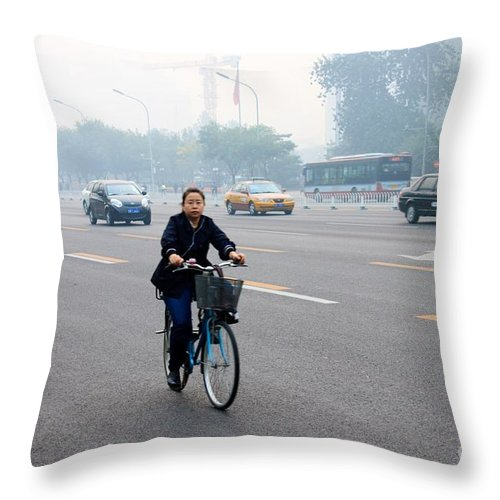 Bicycle Throw Pillow featuring the photograph Bicyclist In Beijing by Thomas Marchessault