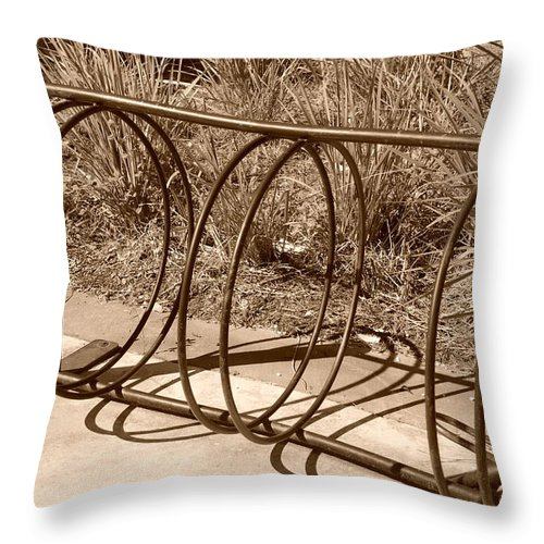Bicycle Throw Pillow featuring the photograph Bike Rack by Rob Hans