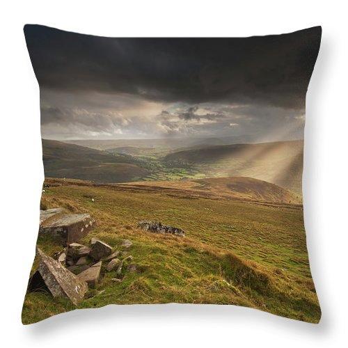 Black Mountains Throw Pillow featuring the photograph Black Mountains Light Rays by Nigel Forster