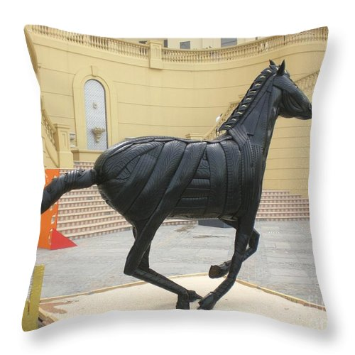 Horse Throw Pillow featuring the sculpture Black Stalion Tyre Sculpture by Mo Siakkou-Flodin