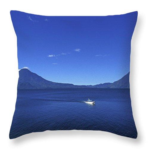 Guatemala Throw Pillow featuring the photograph Boat On Lake Atitlan Guatemala by John Mitchell