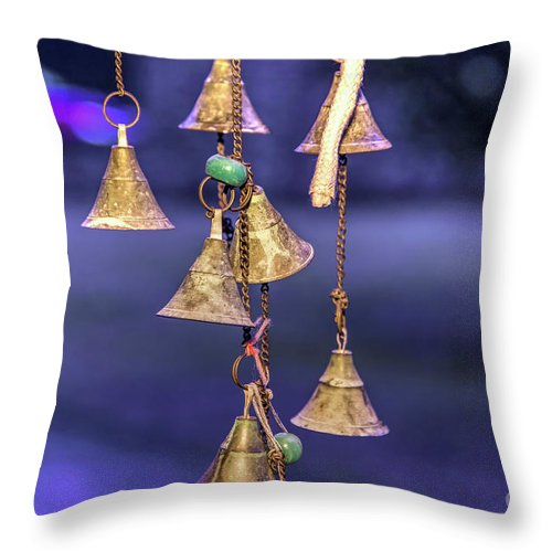 Objects Throw Pillow featuring the photograph Brass Bells Hanging In The Illuminated Courtyard At Winter Night by Bratislav Stefanovic