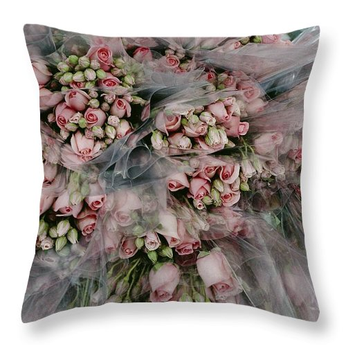 Plants Throw Pillow featuring the photograph Bundles Of Pink Roses Are Gathered by Sisse Brimberg