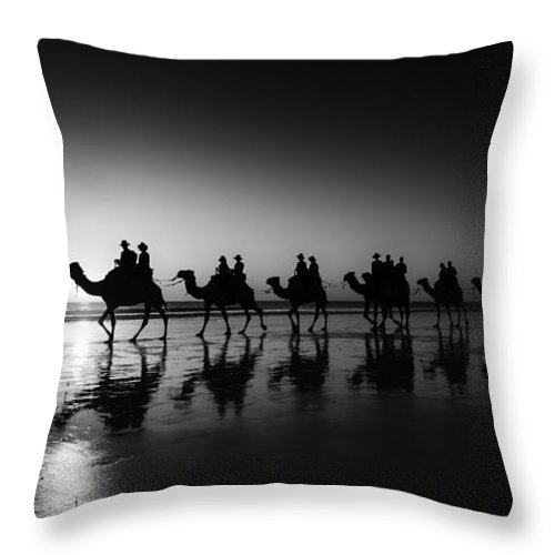 Broome Throw Pillow featuring the photograph Camels On The Beach by Chris Cousins