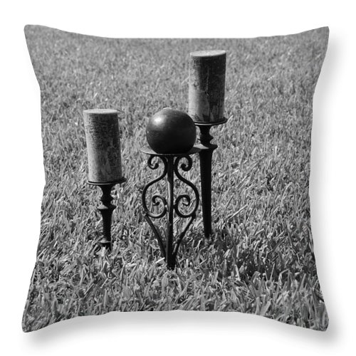 Black And White Throw Pillow featuring the photograph Candles In Grass by Rob Hans