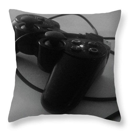 Sony Playstation Throw Pillow featuring the photograph Can't Play Without It by WaLdEmAr BoRrErO