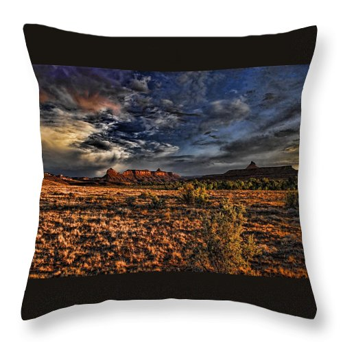 Dramatic Sky Throw Pillow featuring the photograph Canyonlands At Dusk by Nick Roberts