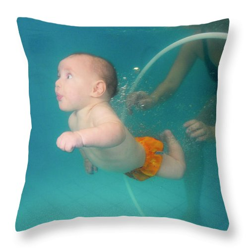 Underwater Throw Pillow featuring the photograph Child Swims Underwater by Hagai Nativ