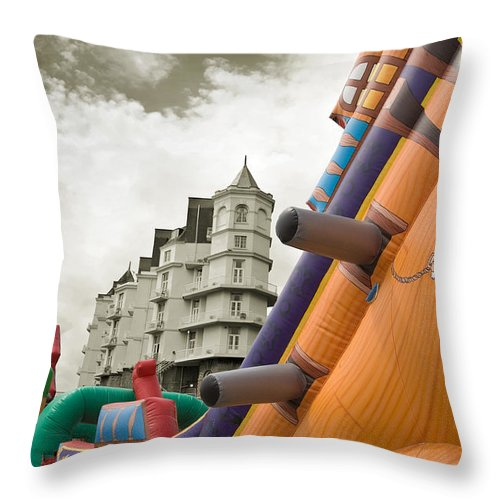 Childrens Throw Pillow featuring the photograph Childrens Play Areas Contrast With The Victorian Elegance Of The Grand Hotel In Llandudno Wales Uk by Mal Bray