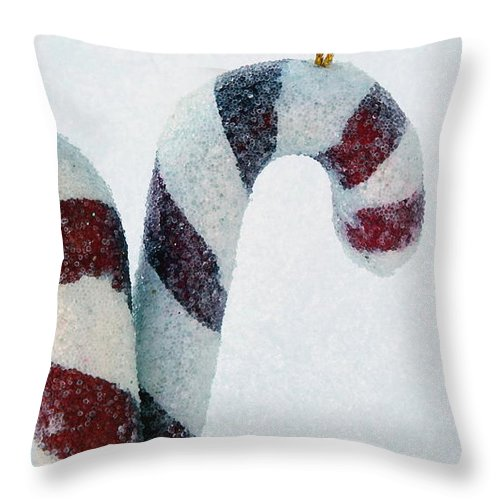 Christmas Throw Pillow featuring the photograph Christmas Candy Canes On Real Snow by Isabelle Haynes