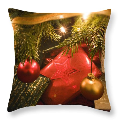 Christmas Throw Pillow featuring the photograph Christmas Tree Decorations And Gifts by Mal Bray