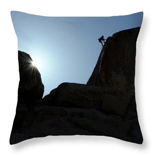 Joshua Tree National Park Throw Pillow featuring the photograph Climbing In Joshua Tree by Bob Christopher