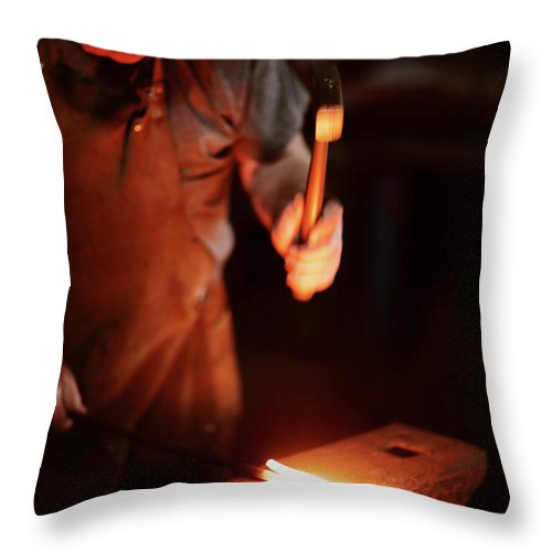 Blacksmith Throw Pillow featuring the photograph Close-up Of Blacksmith Forging Hot Iron by Johan Swanepoel