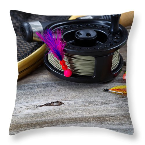Fishing Throw Pillow featuring the photograph Close Up Of Fly Reel With Fly Jig Hanging From Spool by Thomas Baker