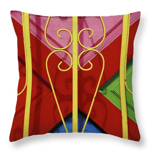 Colourful Throw Pillow featuring the photograph colourful abstract urban photography - The Red Cross by Sharon Hudson