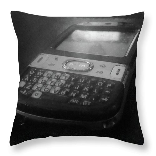 Cell Phone Throw Pillow featuring the photograph Communication Device by WaLdEmAr BoRrErO