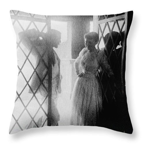 19th Century Throw Pillow featuring the photograph Couple In Doorway by Granger