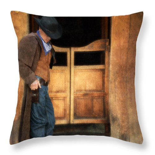 Cowboy Boots Throw Pillow featuring the photograph Cowboy By Saloon Doors by Jill Battaglia