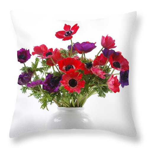 Flower Throw Pillow featuring the photograph crown Anemone in a white vase by Ilan Amihai
