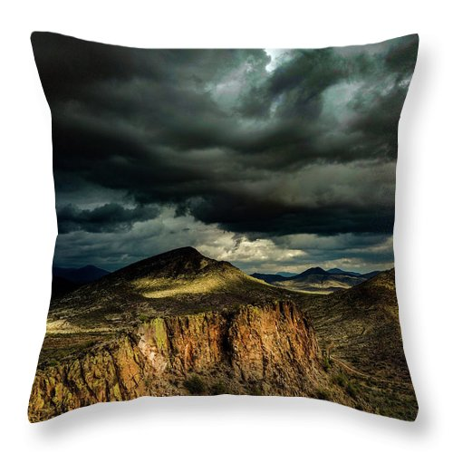Drone Photography Throw Pillow featuring the photograph Dark Storm Clouds Over Cliffs by David Stevens