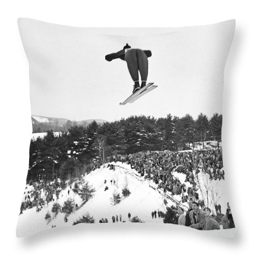 1950's Throw Pillow featuring the photograph Dartmouth Carnival Ski Jumper by Underwood Archives