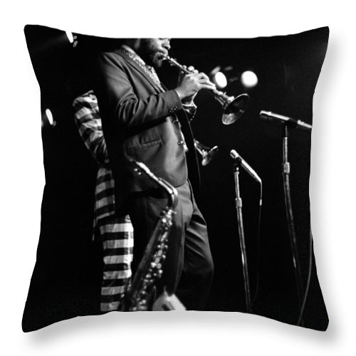 Ornette Coleman Throw Pillow featuring the photograph Dewey Redman On Musette by Lee Santa