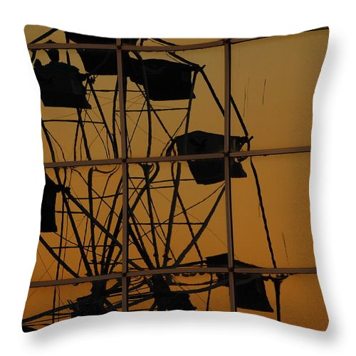 Ferris Wheel Throw Pillow featuring the photograph Distorted Reflection by Jean Booth