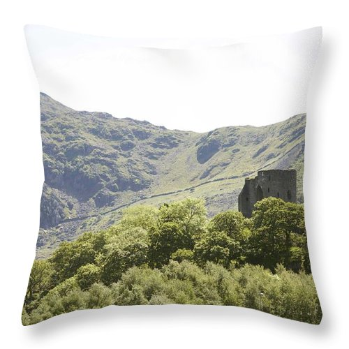 Castles Throw Pillow featuring the photograph Dolbadarn Castle. by Christopher Rowlands