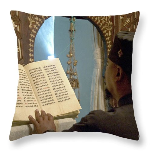 Christian Throw Pillow featuring the photograph Ethiopian Priest by Danny Yanai