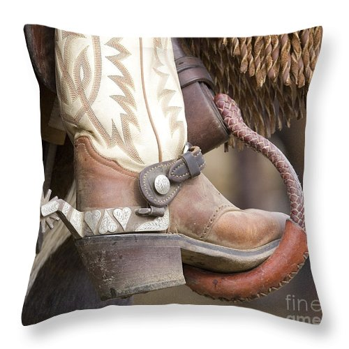 Cowboy Throw Pillow featuring the photograph Fancy Foot by Carol Walker