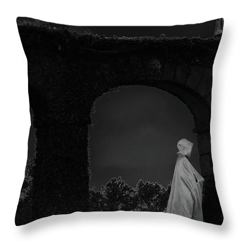 Mysterious Throw Pillow featuring the photograph Figure In The Night by Nadalyn Larsen