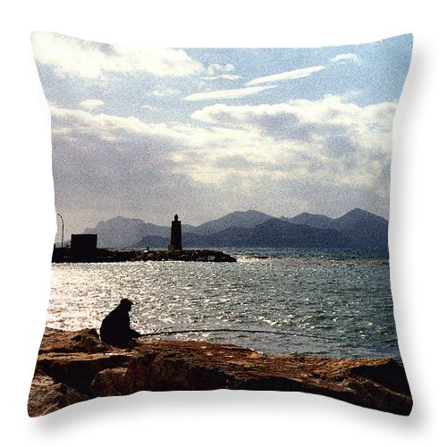 Fisherman Throw Pillow featuring the photograph Fisherman In Nice France by Nancy Mueller