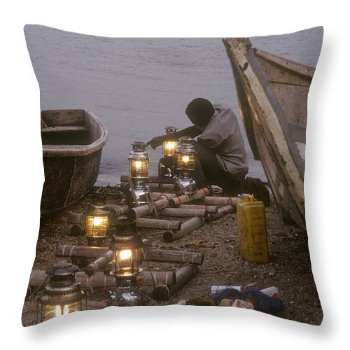 Uganda Throw Pillow featuring the photograph Fisherman Prepares Lanterns For Night by Michael S. Lewis