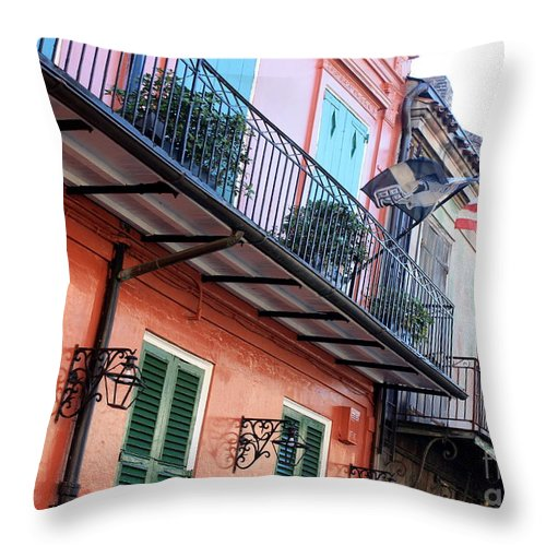 New Orleans Throw Pillow featuring the photograph Flags On The Balcony by Carol Groenen