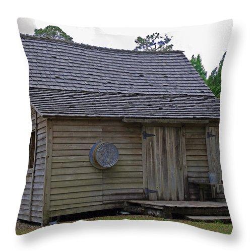 Cracker; Florida; Cabin; Rain; Light; Falls; 1900's; Farmer; Farm; Citrus; Oranges; Orlando; Mature; Throw Pillow featuring the photograph Florida Cracker Cabin Circa 1900 by Allan Hughes