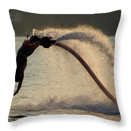 Bodrum Throw Pillow featuring the photograph Flyboarder About To Enter Water With Hands by Ndp