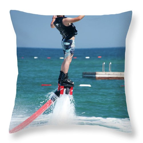 Bodrum Throw Pillow featuring the photograph Flyboarder Falling Backwards Next To Swimming Platform by Ndp