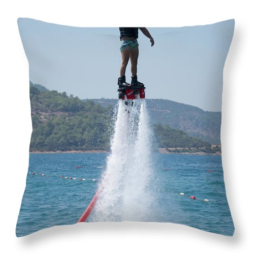 Bodrum Throw Pillow featuring the photograph Flyboarder Giving Victory Sign With One Hand by Ndp