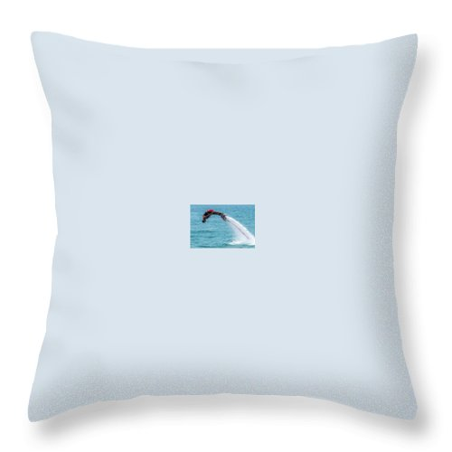 Bodrum Throw Pillow featuring the photograph Flyboarder In Red Followed By Water Jet by Ndp
