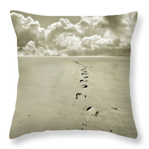 Footprints Throw Pillow featuring the photograph Footprints In Sand by Mal Bray