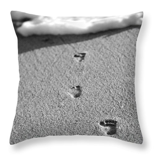 Sand Throw Pillow featuring the photograph Footprints in the Sand black and white by Jill Reger