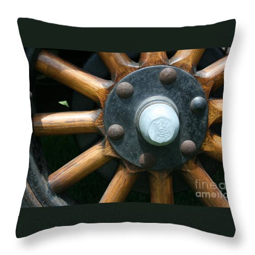 Wagon Throw Pillow featuring the photograph Ford Wagon Wheel by Dawn Downour