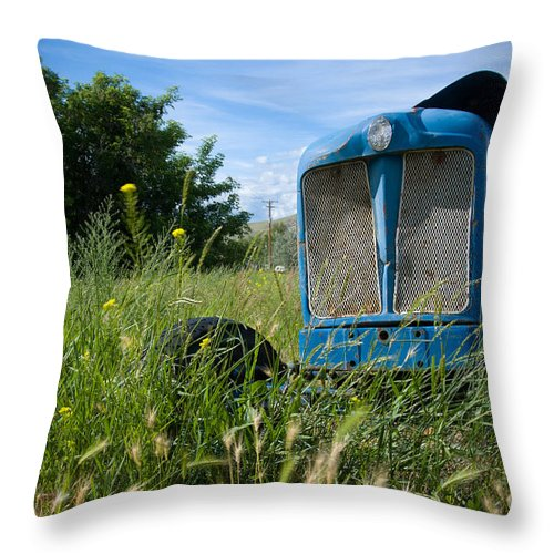 Tractor Throw Pillow featuring the photograph Fordson Deisel by Idaho Scenic Images Linda Lantzy