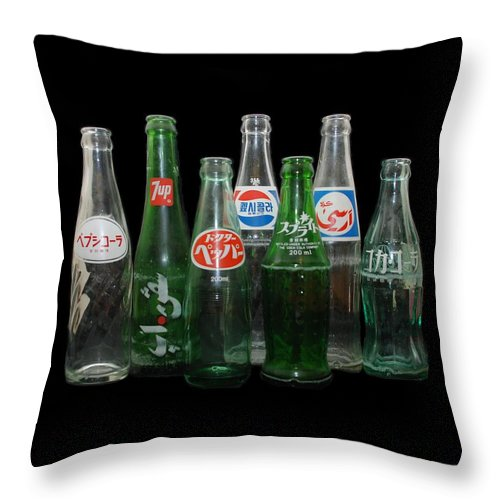 Pepsi Throw Pillow featuring the photograph Foreign Cola Bottles by Rob Hans