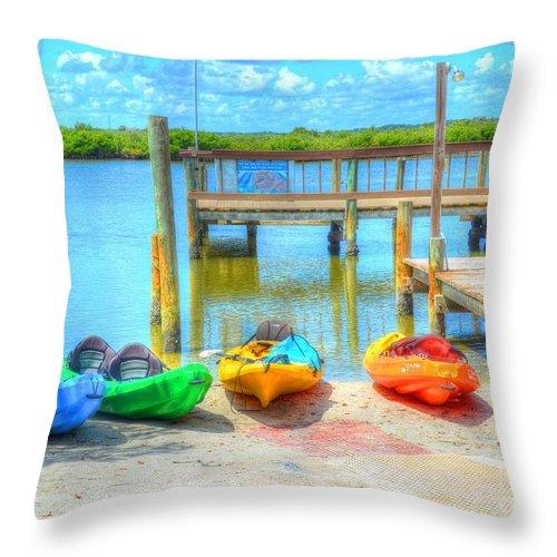 Kayaks Throw Pillow featuring the photograph Four Kayaks by Debbi Granruth