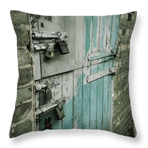 Photo Throw Pillow featuring the photograph Four Latches by Julia Raddatz